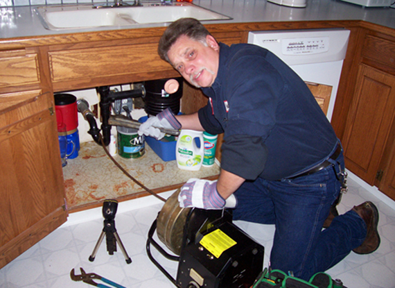 Clogged kitchen drain cleaning grumpys drains for How to fix a clogged kitchen sink