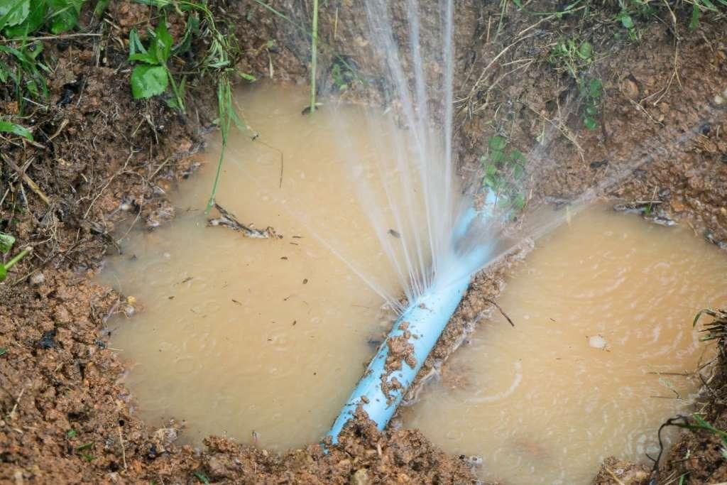 Burst pipe underground from overflowing rain drain