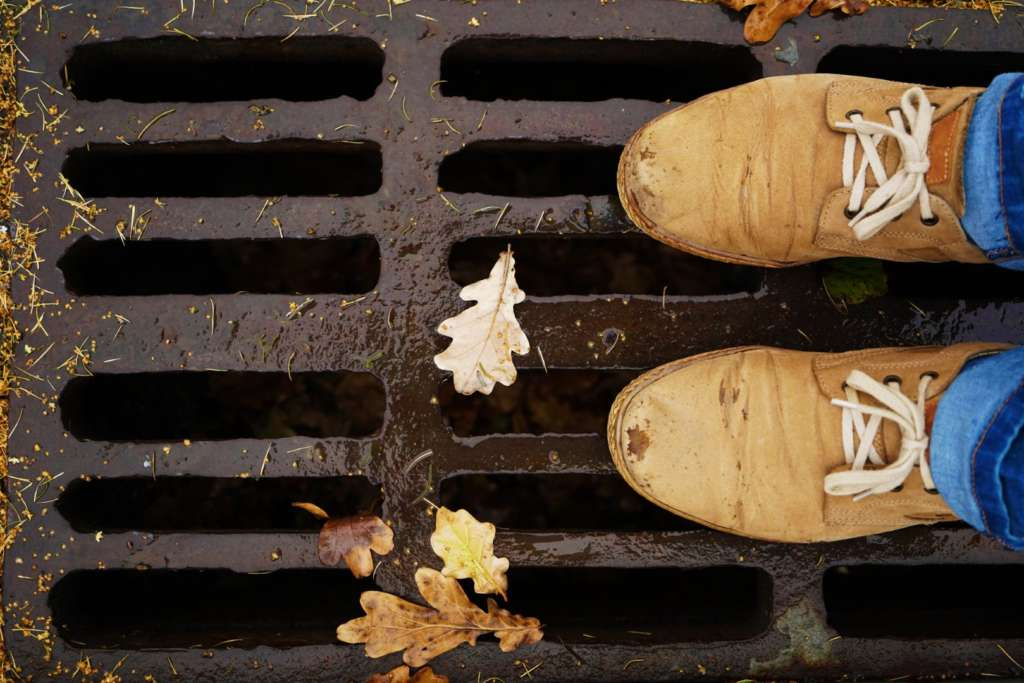 Best draincleaners in portland standing over sewer grate