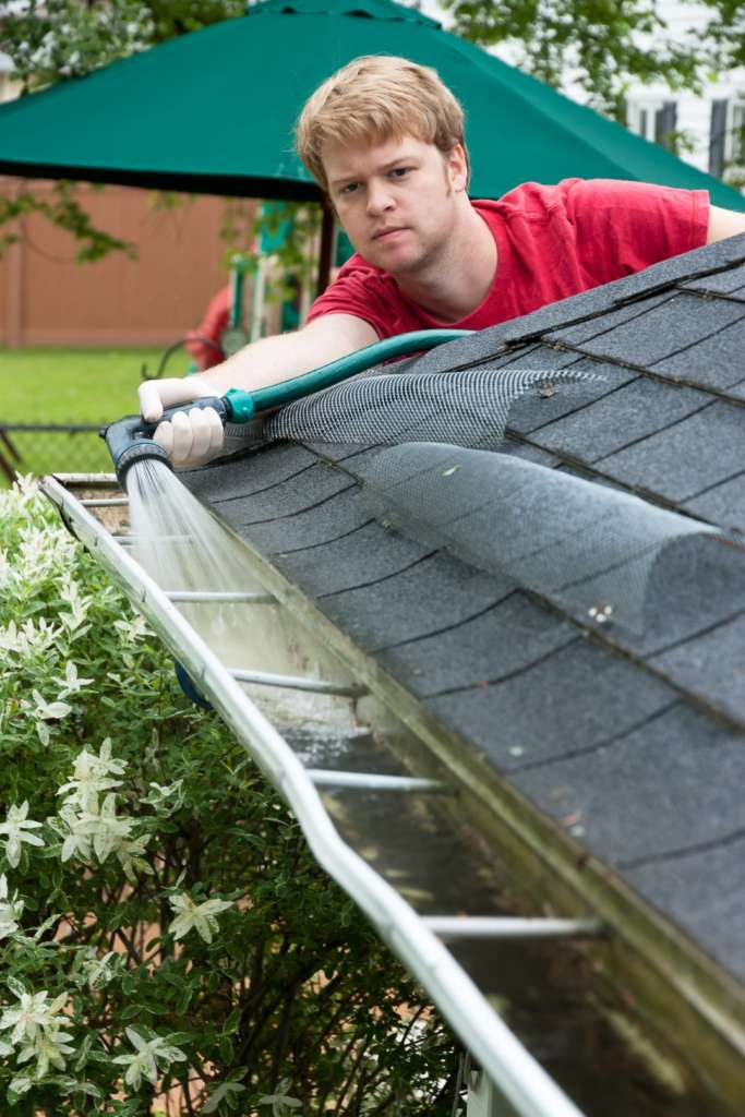 Importance of rinsing gutters after cleaning in portland